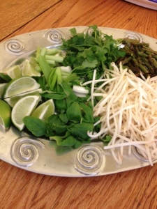 A platter of accoutrements from a batch of homemade pho ga